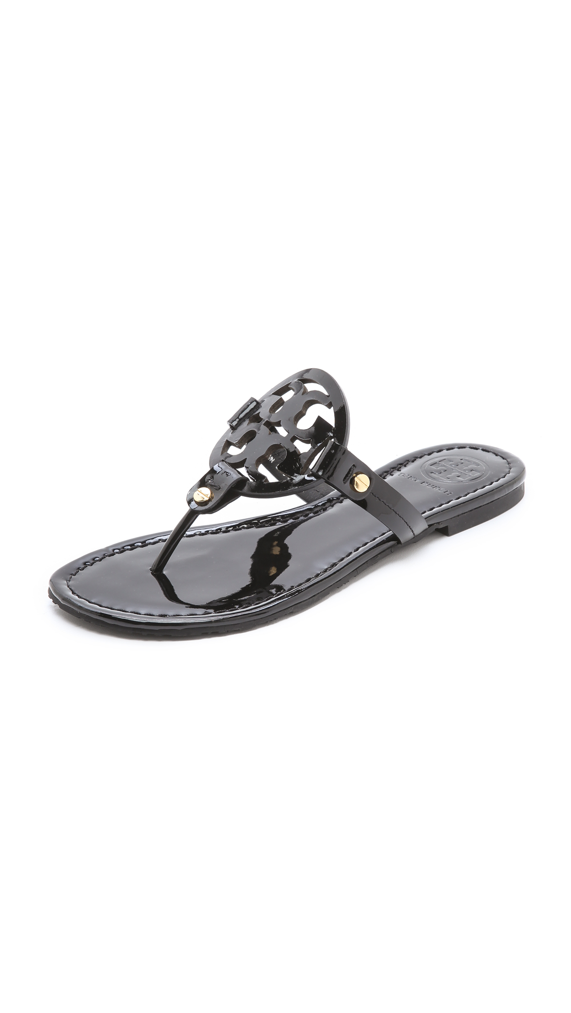 Miller Medallion Patent Leather Flat Thong in Black