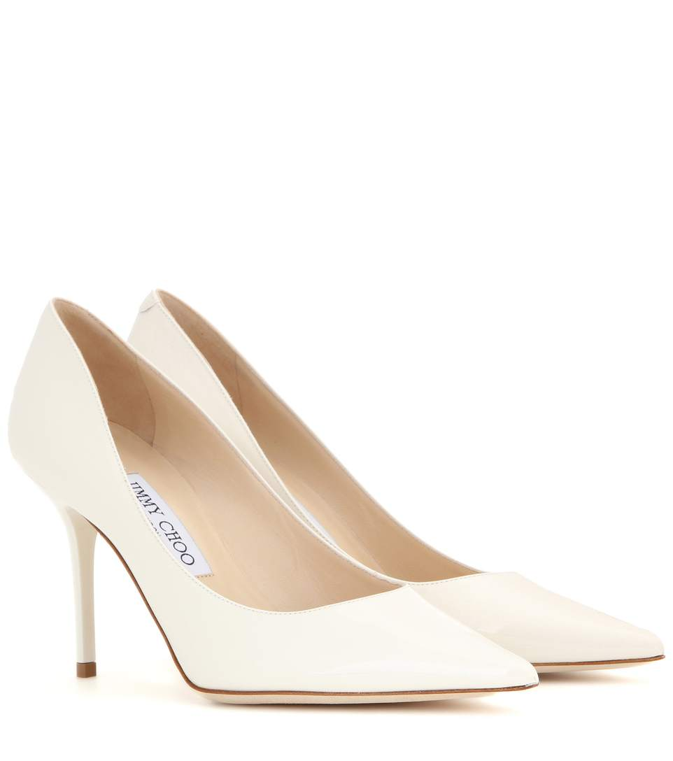 Romy 85 Patent Leather Pumps in Off White