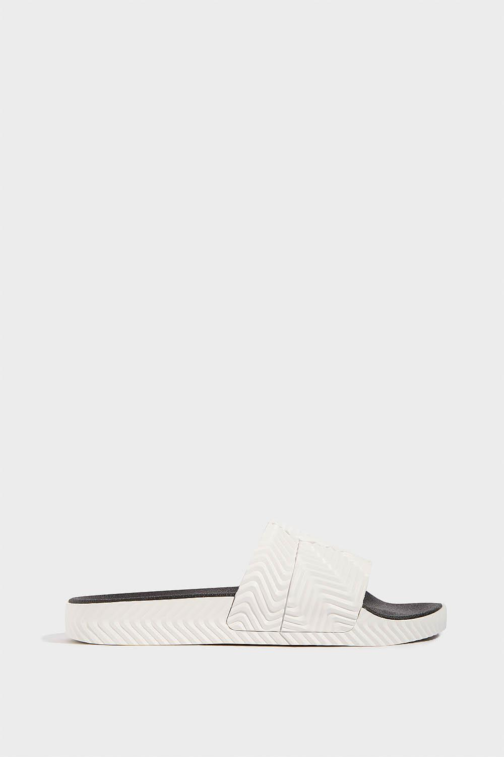 Adidas By Alexander Wang Adilette Slides In White from EAST DANE